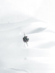Delicate diamond solitaire on hand with thin band and double claw prongs in platinum - Bailey