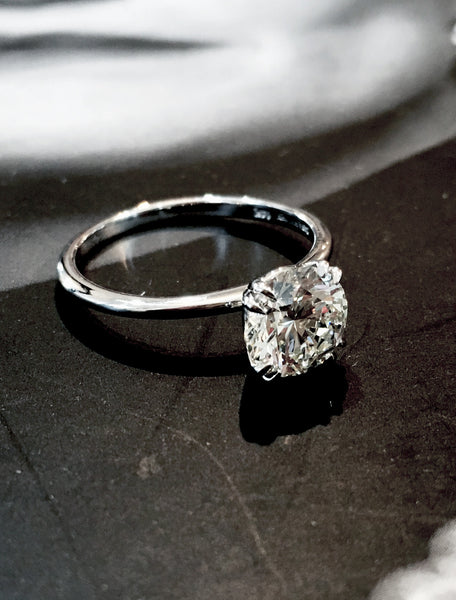 bailey double claw diamond solitaire in white gold