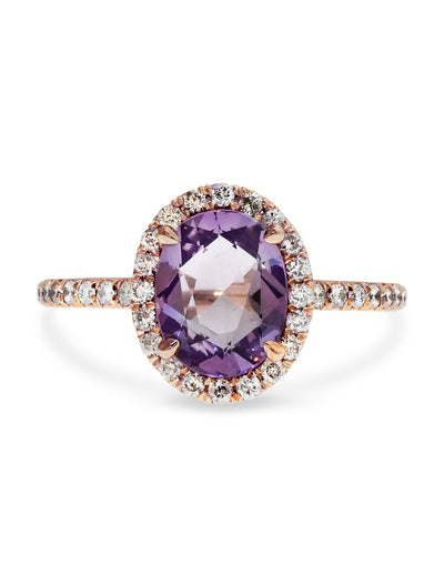 2.12 carat purple sapphire halo engagement ring in thin rose gold setting, designed by Dana Walden Bridal in NYC