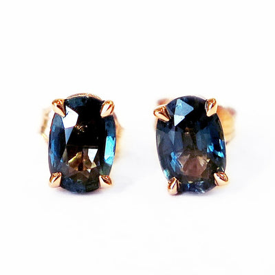Oval stud earrings with juicy and rich teal sapphires in a rose gold setting. Designed and handmade by Dana Walden NYC.