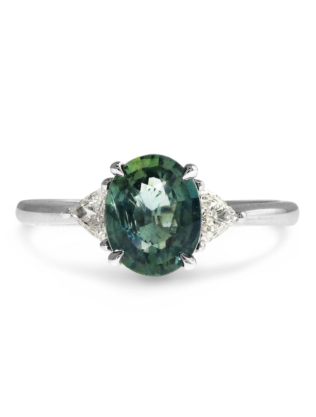 Cheryl unique green-grey sapphire three stone engagement ring with trillion diamonds in white gold