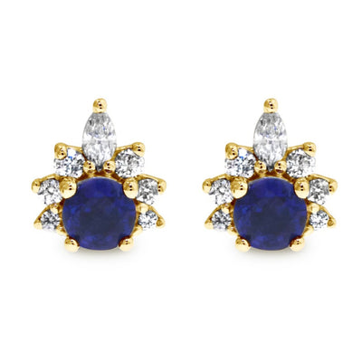 Deep blue sapphire earrings with diamond demi halo. Stud earrings set in yellow gold by Dana Walden.