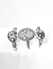 A trio of classic diamond engagement rings in platinum by Dana Walden Bridal