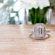 Custom Emerald Cut Halo Engagement Ring with Baguette and Round Diamonds in Platinum
