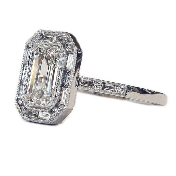Emerald Cut Diamond Halo, side profile in Platinum with Baguette & Round Diamonds