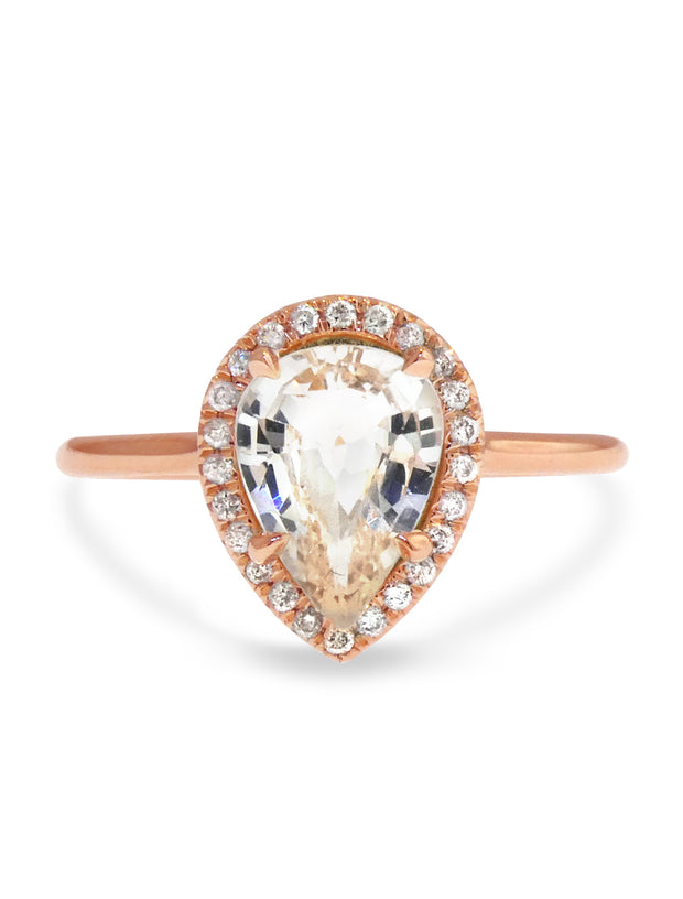 pale peach sapphire engagement ring in rose gold halo design with conflict free diamonds, by dana walden bridal in nyc
