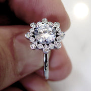 Nature inspired diamond engagement ring in platinum with conflict free diamonds and thin band - Fleurette