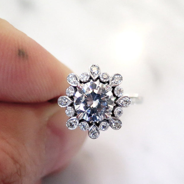 Floral inspired diamond engagement ring with unique details in platinum - Fleurette