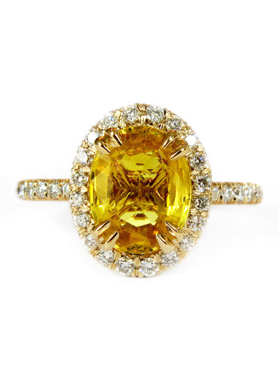 Gia oval yellow sapphire halo engagement ring in yellow gold with delicate diamond band