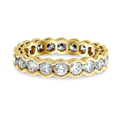 2 carat diamond eternity band 'Gilda' in yellow gold with a scalloped bezel by Dana Walden Bridal nyc