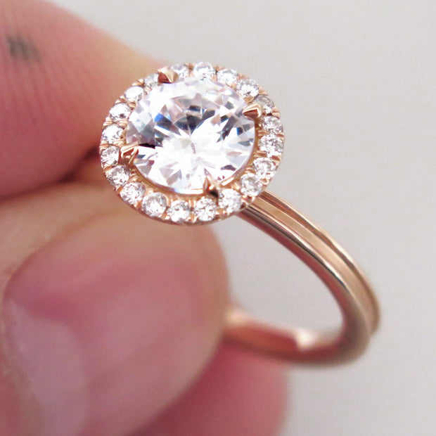 Rose gold halo engagement ring with unique beveled band and conflict free diamonds handmade in nyc