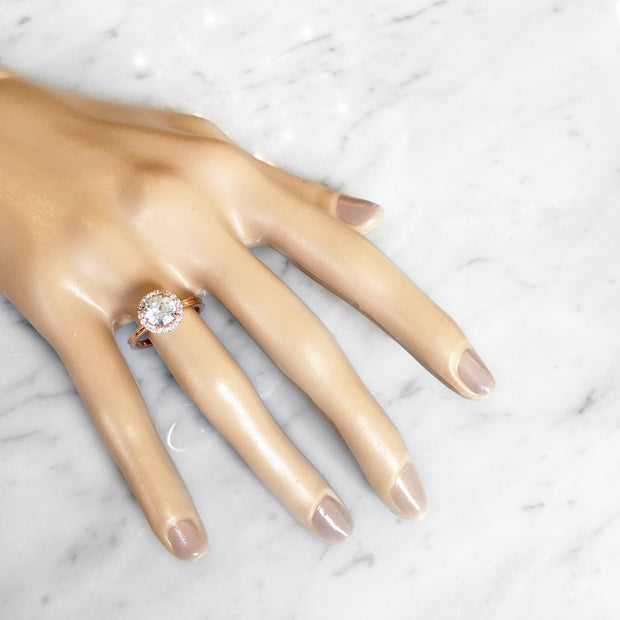 Unique rose gold & diamond halo on hand - Giselle