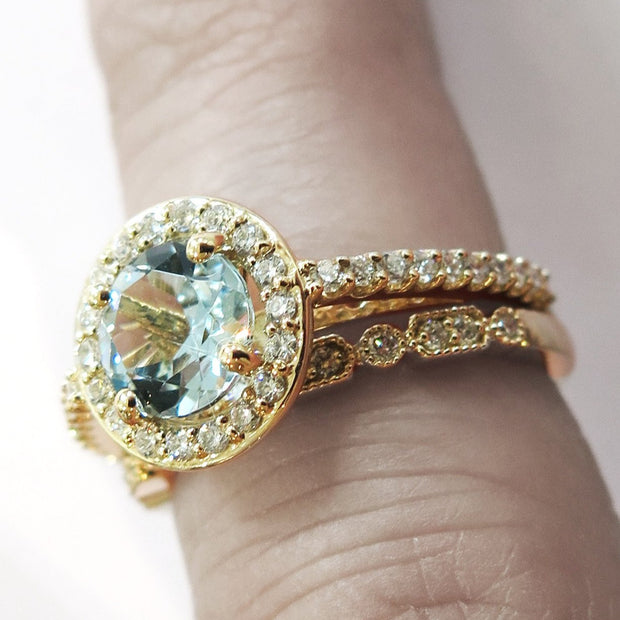 Aquamarine Halo Engagement Ring in Yellow Gold With Diamond Accents On Hand by Dana Walden Bridal, NYC