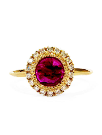 Ruby and diamond halo engagement ring in yellow gold with vintage inspired details