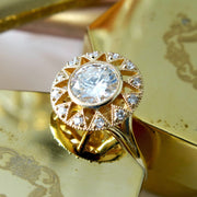 Artistic diamond engagement ring in yellow gold with milgrain and diamond accents handmade in nyc