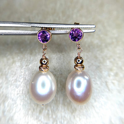 Iyla freshwater pearl drop earrings with amethyst gems. Handmade in the USA by Dana Walden Jewelry.