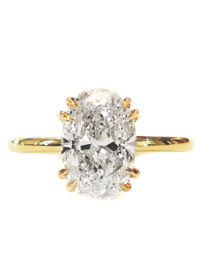 Oval diamond engagement ring in yellow gold, solitaire setting, double prongs & thin band