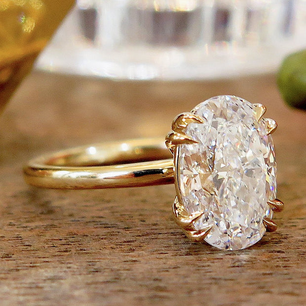 Oval diamond solitaire, yellow gold engagement ring, side profile, delicate custom band