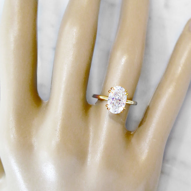 2 carat oval diamond solitaire, yellow gold engagement ring, ultra thin band, on hand