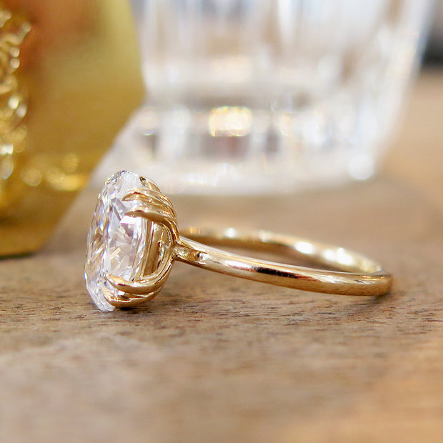 Oval diamond engagement ring, solitaire setting, yellow gold, side profile, 2 carat diamond