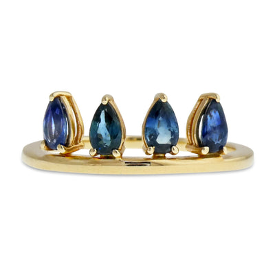 Larkyn is a ring with four pear-shaped blue sapphires set vertically along a gold band. Handmade by Dana Walden Jewelry in NYC USA.