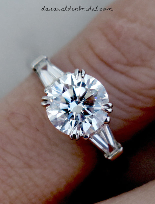 Classic three stone diamond engagement ring with baguettes on hand - Leandra