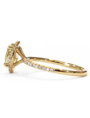 Linza thin diamond halo from side in yellow gold with conflict-free diamond accents