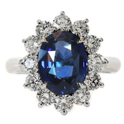 Kate Middleton style engagement ring in blue sapphire and diamond halo - Dana Walden - NYC