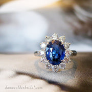 Kate Middleton style custom engagement ring featuring a 3 carat oval cut royal blue sapphire