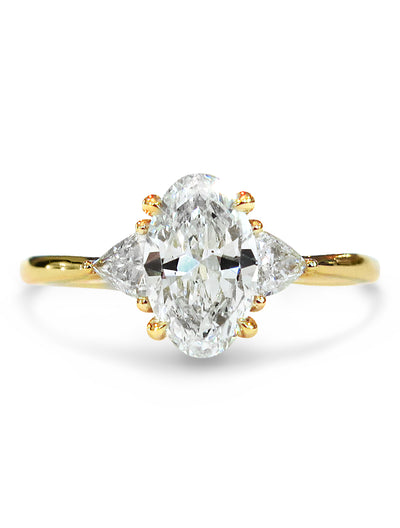 Lucine oval diamond 3 stone engagement ring in yellow gold with trillion side stones