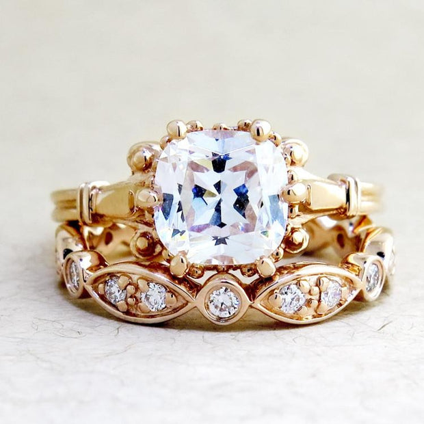 Rose gold bridal set featuring Lulu engagement ring & India wedding band