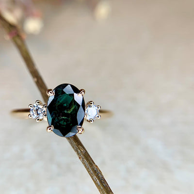 Unique, handmade teal sapphire engagement ring, made with conflict-free gemstones by Dana Walden Bridal in New York City.