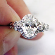 Unique oval diamond halo with nature inspired details in platinum - Maiya