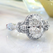Oval diamond halo in platinum with organic details - Maiya