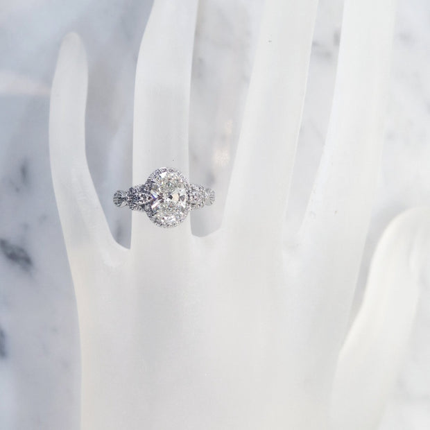 Unique oval diamond halo on hand in platinum with conflict free diamonds - Maiya