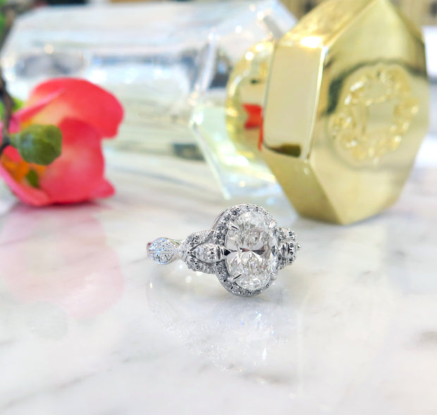 Nature inspired oval diamond halo in platinum - Maiya