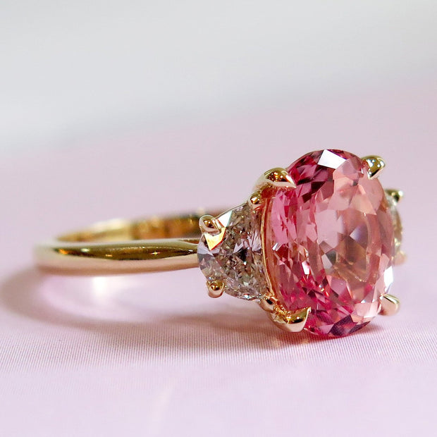 Oval Cut Peach Sapphire Engagement Ring with 3.76 Carat Padparadscha in Yellow Gold & Half Moon Diamonds