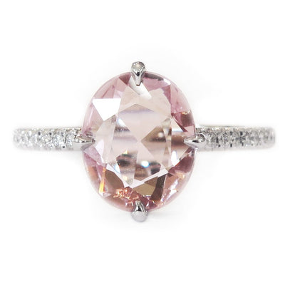 Unique 2.25 carat peach sapphire engagement ring with thin diamond band in white gold