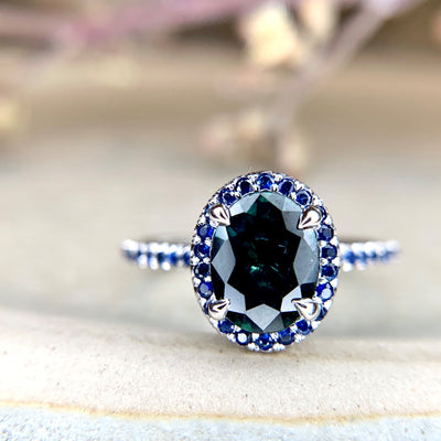 Gothic, handmade engagement ring with teal and blue sapphires set in white gold. Dana Walden Jewelry NYC.