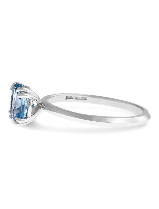 Nontraditional Aquamarine engagement ring with knife edge band in white gold side profile