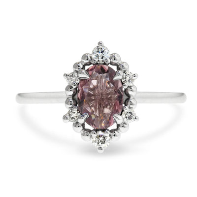 Mauve sapphire engagement ring in unique diamond halo designed by Dana Walden Bridal