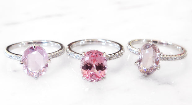 Peach and pink sapphire engagement rings with thin diamond bands in white gold or platinum