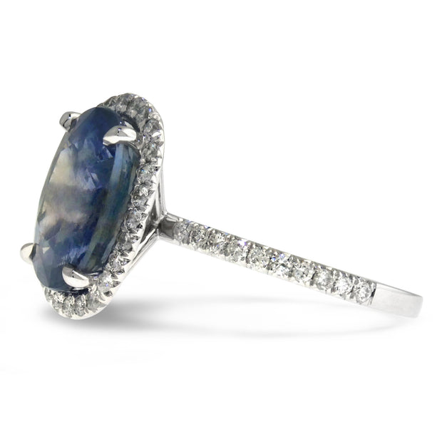 Valora 6 carat blue grey sapphire halo engagement ring in white gold with conflict free diamonds oval cut side profile