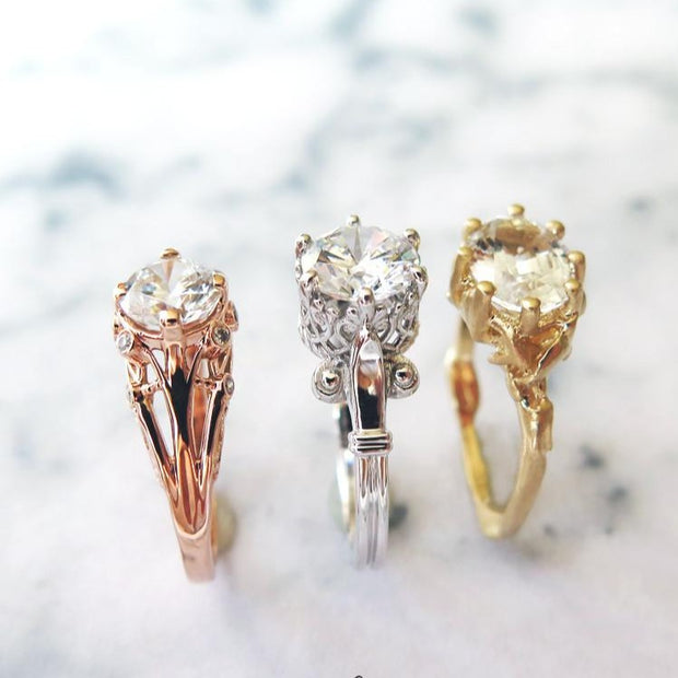 A trio of unique diamond engagement rings in yellow, rose, and white gold by Dana Walden Bridal, NYC