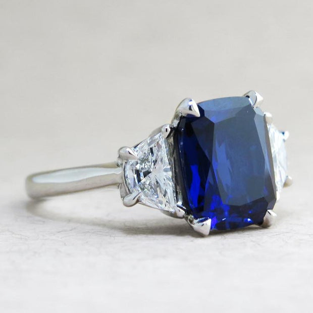 Blue sapphire engagement ring with half moon diamond accents in platinum - side profile - Alexandra
