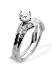 Desirée Sculptural Diamond Wedding Ring in Platinum Shown with Celine Engagement RIng