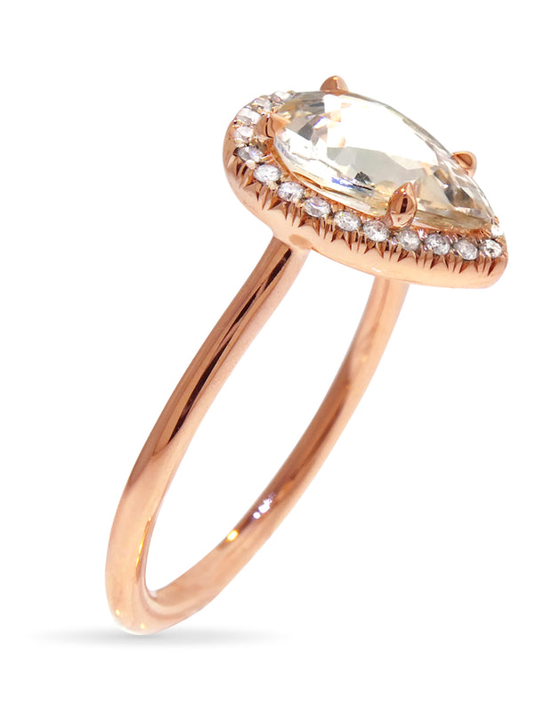 pale peach pear sapphire engagement ring in rose gold halo, side image, designed by dana walden bridal in nyc
