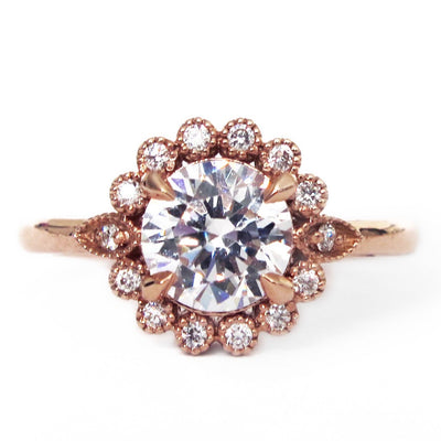 Handmade unique diamond halo engagement ring that resembles a floral bloom. Rose gold setting handmade by Dana Walden Bridal NYC.