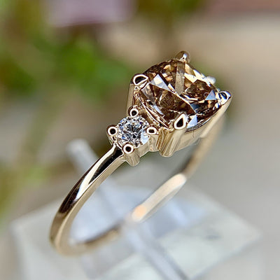 1 carat cushion champagne diamond three stone engagement ring with low profile and thin band in yellow gold by Dana Walden Bridal NYC