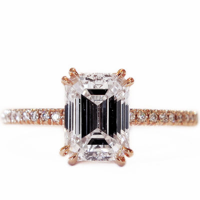 Conflict-free ethical emerald cut diamond set in rose gold with micropave band. Dana Walden Bridal.